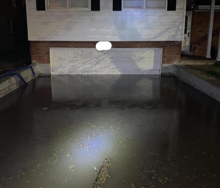 Photo showing a flooded driveway and garage