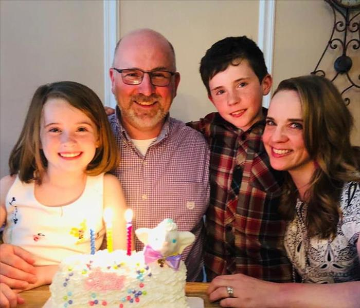 Picture of the Thompson family celebrating a birthday