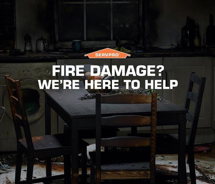 "A fire damage kitchen table & chairs along with the SERVPRO logo and text that reads ""Fire damage? We're here to help."""
