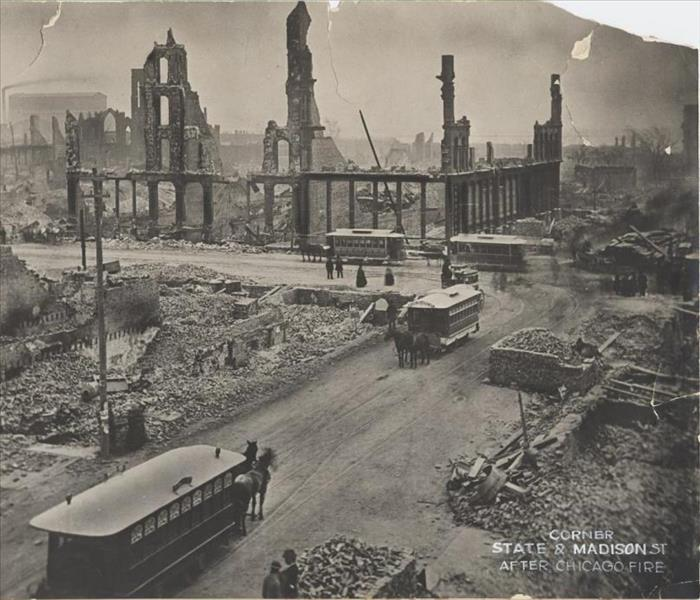 Photo shows the devastation at the intersection of State and Madison Streets following the Great Chicago Fire