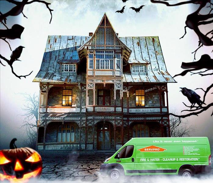 Spooky image of a haunted house, a jack-o-lantern, and the SERVPRO service van.